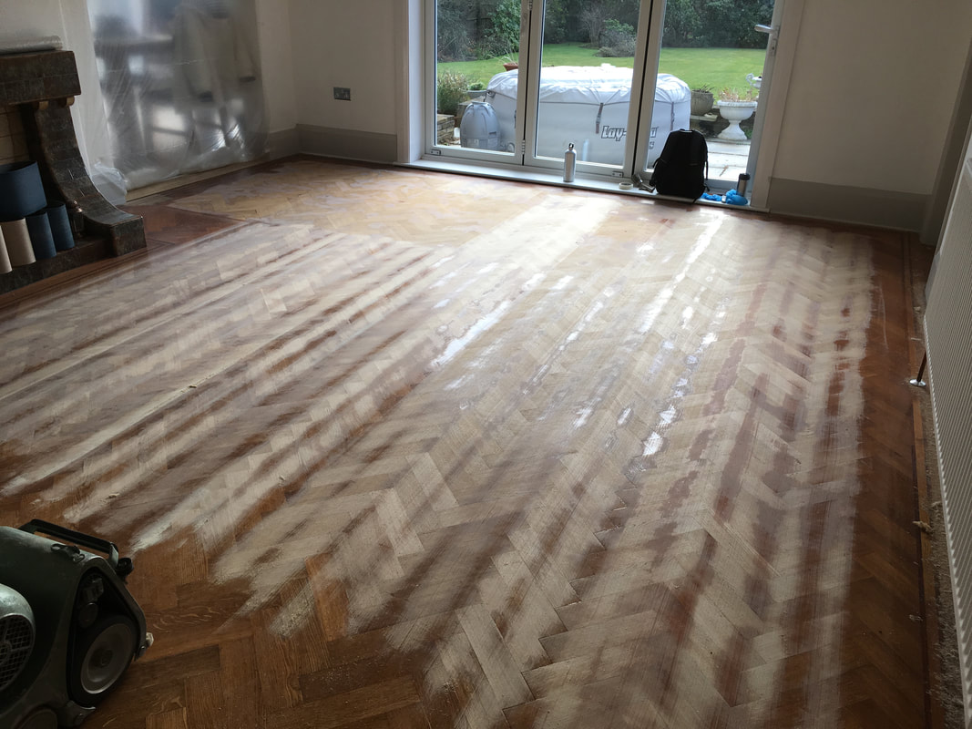 during the sanding process of solid oak herringbone parquet flooring in the wirral
