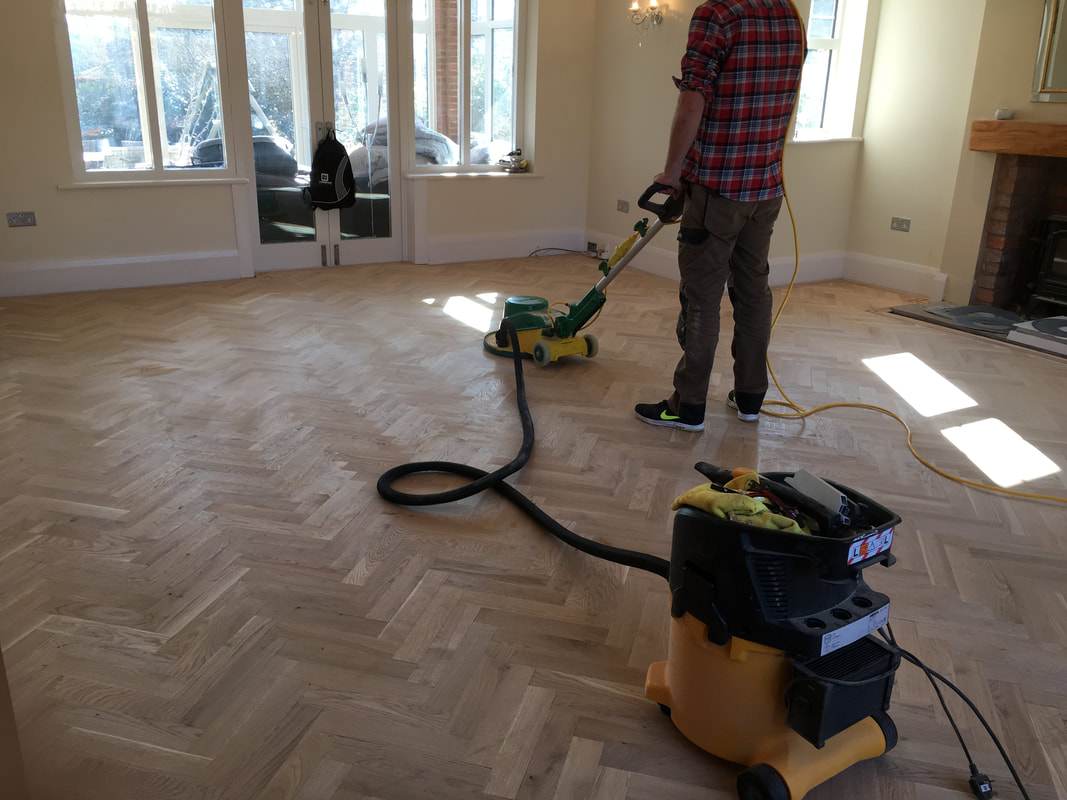 lager floor sanding equipment being used with mirka dust extraction to finish a parquet floor in heswall